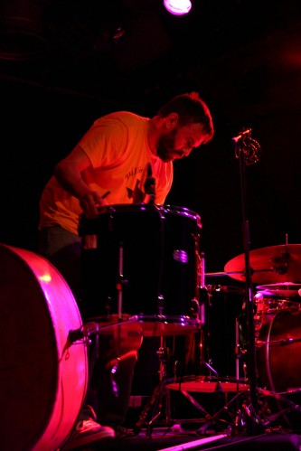 A drummer looks down onto some drums