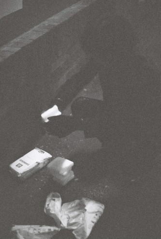 Unpacking dry ice on the floor of the Arches Theatre in the dark