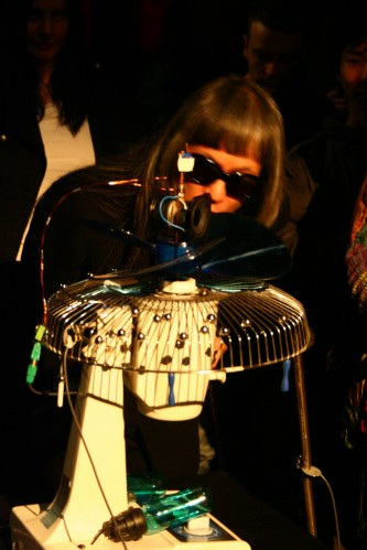 A fan obscures part of Keiji Haino's face yet he is still clearly recognisable