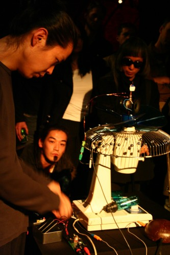 Tetuya Umeda performs with an adapted fan, Keiji Haino in the background