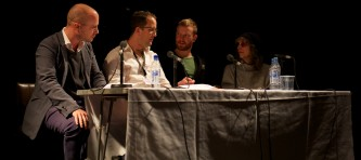 a table of four people taking part in a panel discussion