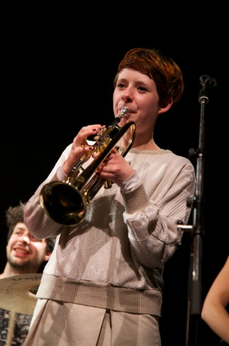 A trumpet player performs on stage