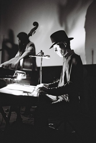 Jandek playing a keyboard at Anthology Film Archives