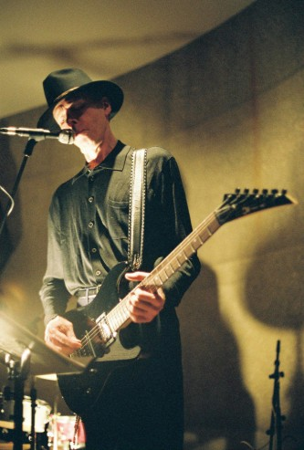 Jandek with pointy metal style guitar at Issue Project Room