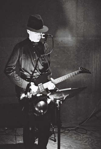 Jandek playing a guitar at Issue Project Room