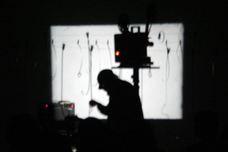 Andrew in silhouette in front of a projection