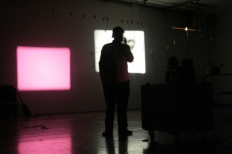 Andrew Lampert in front of projections