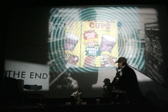Cups for children advert projected on a wall
