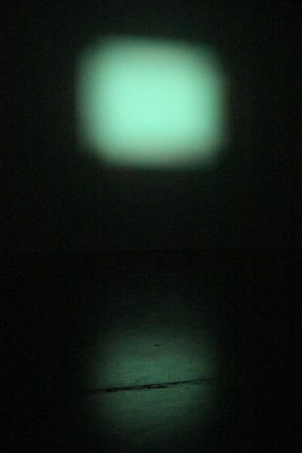 Fuzzy green form projected on a screen