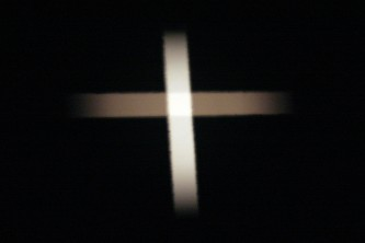 A white cross projected on a screen