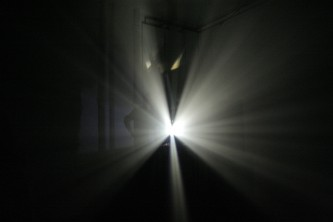 Light spreading out from a projector in breams white