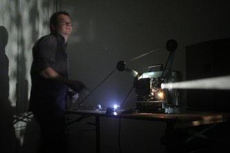 Greg Pope operating a projector