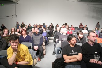 a front shot of a brightly lit audience