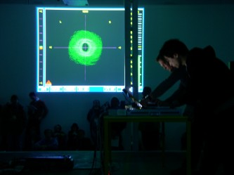 Cyclo performing in front of a projection of a computer screen