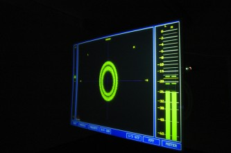 A hanging screen showing data from a computer