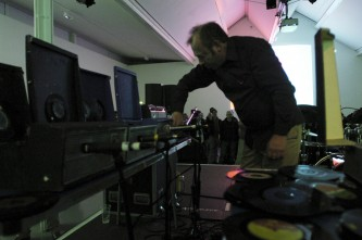 Philip Jeck with tables full of turntables at KYTN 03