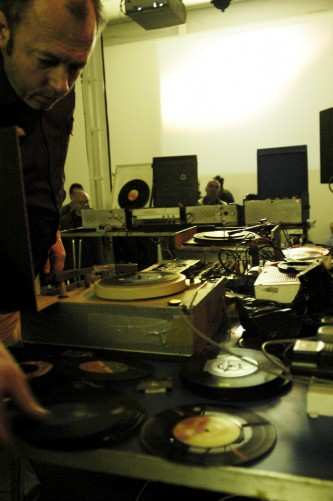 Philip Jeck with tables full of turntables