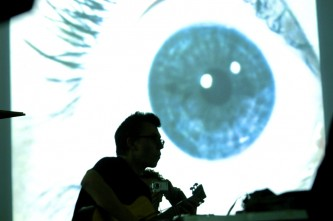 Eyeball projection with guitarist silhouette