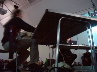 Phonographics seated at a table during performance