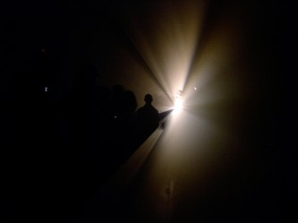 Light coming from a localised point spreading out near an audience