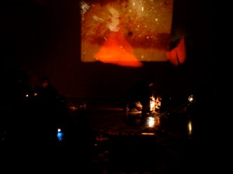 Projection of an abstract orange tone image on a wall