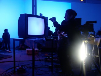Ulrike Flaig working on a cathode ray television in blue light