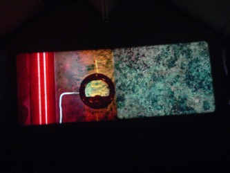Projection of an image of mineral like surfaces and a contact mic
