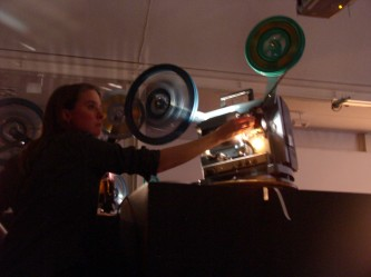 Jennifer Reeves operating a projector in DCA Dundee