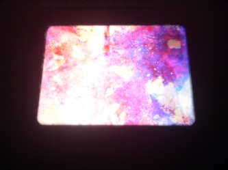 Glowing image of purple mineral textures projected on a wall