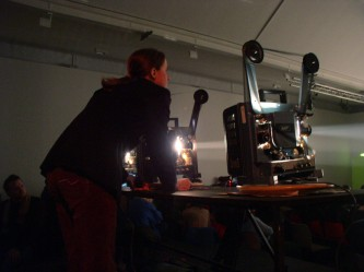 Jennifer Reeves operating projectors in DCA Dundee