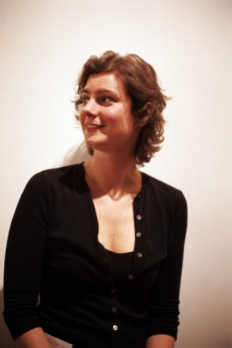 Portrait of Angharad Davies looking sideways in black against a white background
