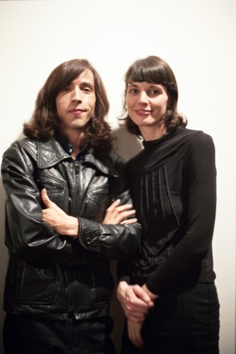 Luis Recoder and Sandra Gibson wearing black in front of a white background