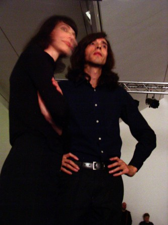 Sandra Gibson and Luis Recoder in black clothes looking beyond the camera