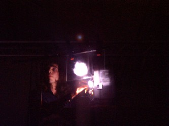 Luis recoder's face lit from the side by a projector