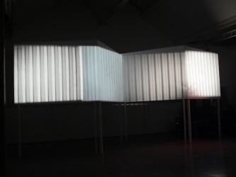 Giant screen made up from different panels with projection of verticle lines