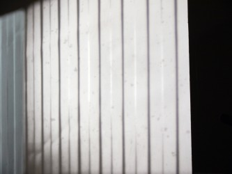 Close up of a projection; vertical lines on a screen