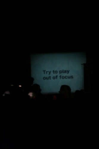 'Try to play out of focus' projected on a wall