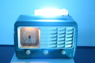An old radio with a fluorescent light on top