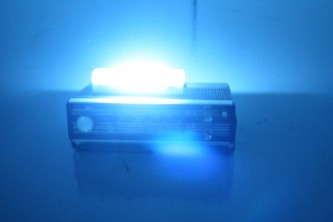 Fuzzy image of an old radio with a fluorescent light on top