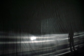Grey bands of light against a sheet of fabric