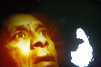 Left side is a person's face in yellow light, right is a white blob
