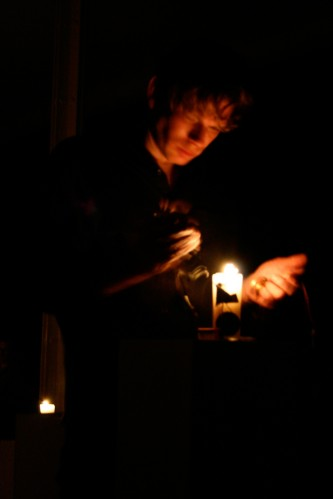 Close up of Joe Colley holding a diode near a candle