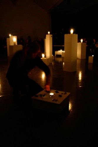 Candles on plinths in a Joe Colley performance