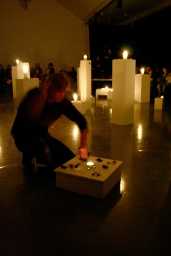 Joe kneeling by a plinth working with one of the candles