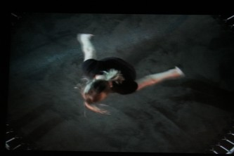 Projection still of Aileen jumping on a trampoline, from above