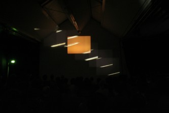 A large room, an orange rectangle, streaks of white light