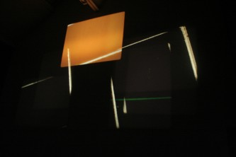 Projection of shards of light and an orange rectangle