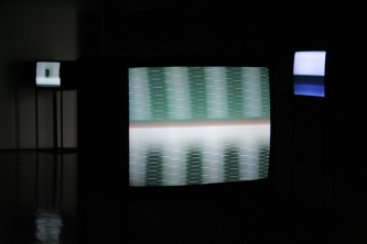 Cathode Ray Monitors showing abstract images in a gallery