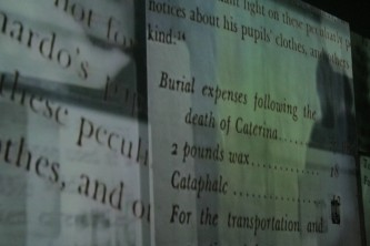 Quotations from texts projected onto a wall, a long screen
