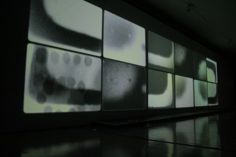 Rectangular forms projected on a long screen, 12 of them